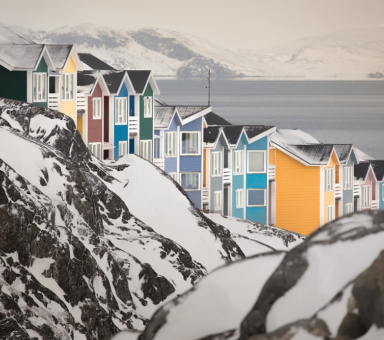 Pastel coloured houses in Nuuk hugging the hillsides in Greenland